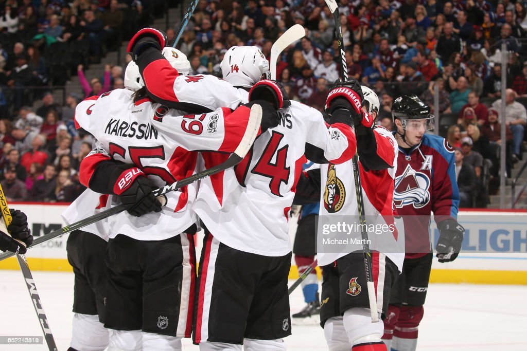 Alexandre Burrows #14 of the Ottawa Senators celebrates a goal against the Colorado Avalanche with teammate Erik Karlsson #65 at the Pepsi Center on March 11, 2017 in Denver, Colorado.