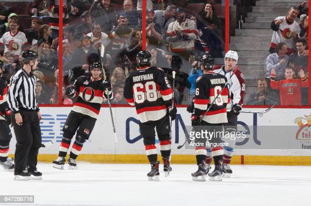 Alexandre Burrows of the Ottawa Senators celebrates his second period goal against the Colorado Avalanche with teammates Mike Hoffman and Chris...