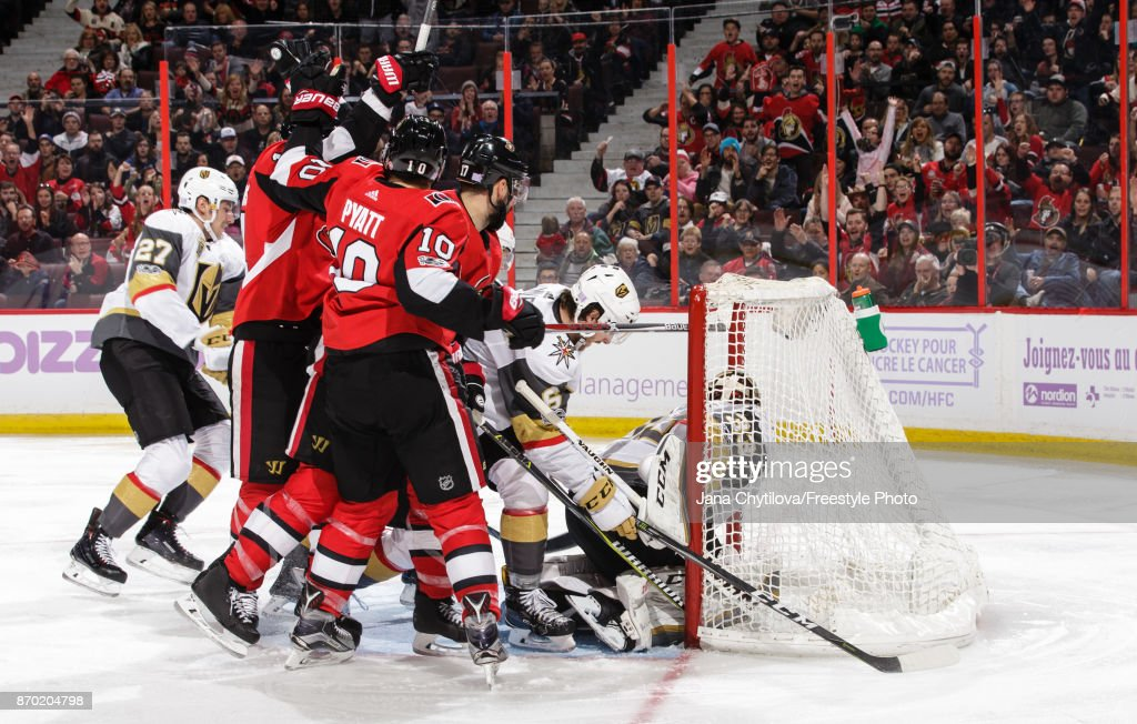 Alexandre Burrows #14 of the Ottawa Senators celebrates his second period goal and 400th career point against of the Vegas Golden Knights with teammates Tom Pyatt #10 and Nate Thompson #17 as Shea Theodore #27, Colin Miller #6 and Maxime Lagace #33 of the Vegas Golden Knights react at Canadian Tire Centre on November 4, 2017 in Ottawa, Ontario, Canada.