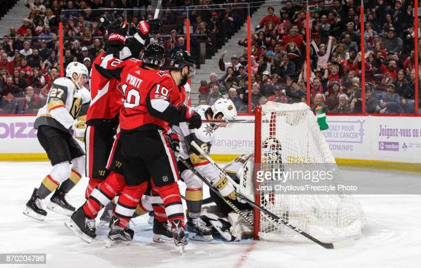 Alexandre Burrows of the Ottawa Senators celebrates his second period goal and 400th career point against of the Vegas Golden Knights with teammates...