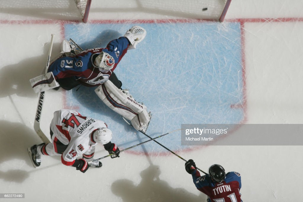 Alexandre Burrows #14 of the Ottawa Senators scores against goaltender Calvin Pickard #31 the Colorado Avalanche at the Pepsi Center on March 11, 2017 in Denver, Colorado. The Senators defeated the Avalanche 4-2.