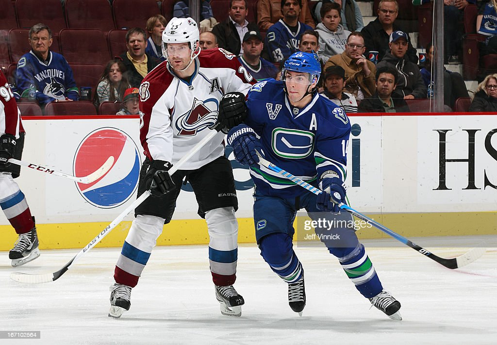 <a gi-track='captionPersonalityLinkClicked' href=/galleries/search?phrase=Alexandre+Burrows&family=editorial&specificpeople=592489 ng-click='$event.stopPropagation()'>Alexandre Burrows</a> #14 of the Vancouver Canucks and <a gi-track='captionPersonalityLinkClicked' href=/galleries/search?phrase=Milan+Hejduk&family=editorial&specificpeople=202129 ng-click='$event.stopPropagation()'>Milan Hejduk</a> #23 of the Colorado Avalanche watch the play during an NHL game at Rogers Arena March 28, 2013 in Vancouver, British Columbia, Canada. Vancouver won 4-1.