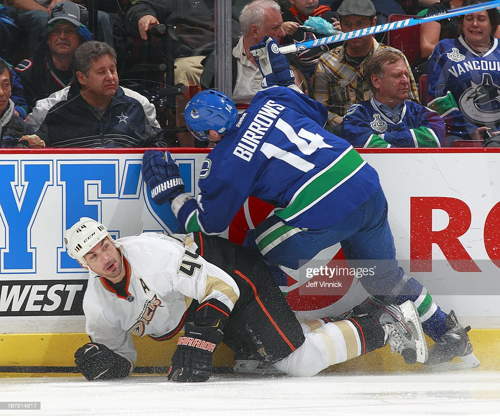 <a gi-track='captionPersonalityLinkClicked' href=/galleries/search?phrase=Alexandre+Burrows&family=editorial&specificpeople=592489 ng-click='$event.stopPropagation()'>Alexandre Burrows</a> #14 of the Vancouver Canucks and <a gi-track='captionPersonalityLinkClicked' href=/galleries/search?phrase=Sheldon+Souray&family=editorial&specificpeople=203131 ng-click='$event.stopPropagation()'>Sheldon Souray</a> #44 of the Anaheim Ducks collide during their NHL game at Rogers Arena April 25, 2013 in Vancouver, British Columbia, Canada.