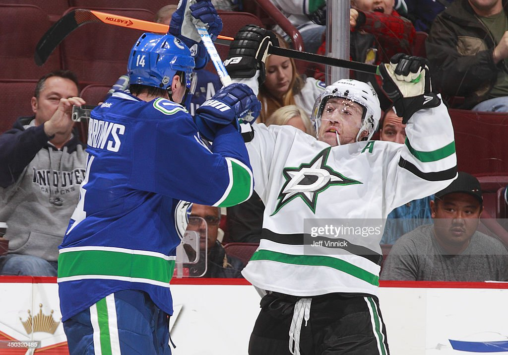 <a gi-track='captionPersonalityLinkClicked' href=/galleries/search?phrase=Alexandre+Burrows&family=editorial&specificpeople=592489 ng-click='$event.stopPropagation()'>Alexandre Burrows</a> #14 of the Vancouver Canucks and <a gi-track='captionPersonalityLinkClicked' href=/galleries/search?phrase=Stephane+Robidas&family=editorial&specificpeople=206166 ng-click='$event.stopPropagation()'>Stephane Robidas</a> #3 of the Dallas Stars collide during their NHL game at Rogers Arena on November 17, 2013 in Vancouver, British Columbia, Canada. Dallas won 2-1.