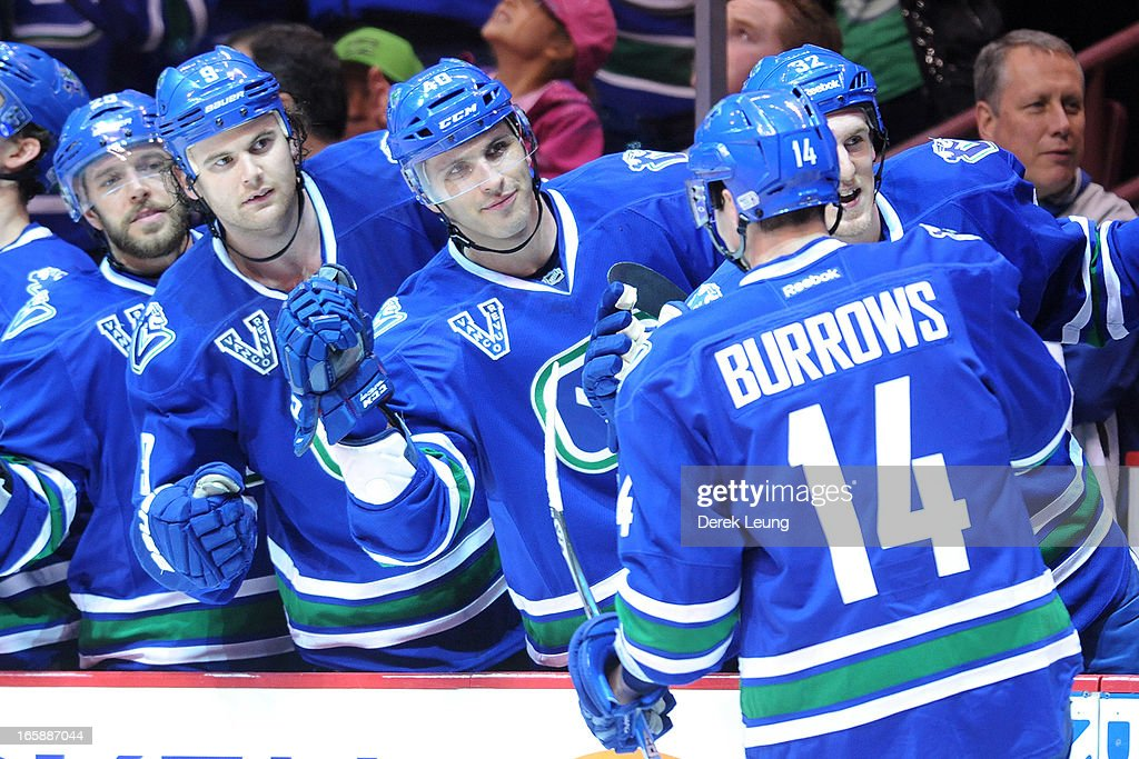 <a gi-track='captionPersonalityLinkClicked' href=/galleries/search?phrase=Alexandre+Burrows&family=editorial&specificpeople=592489 ng-click='$event.stopPropagation()'>Alexandre Burrows</a> #14 of the Vancouver Canucks celebrates his second period goal against the Calgary Flames during an NHL game at Rogers Arena on April 6, 2013 in Vancouver, British Columbia, Canada. The Vancouver Canucks won 5-2.