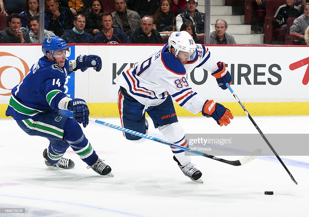 <a gi-track='captionPersonalityLinkClicked' href=/galleries/search?phrase=Alexandre+Burrows&family=editorial&specificpeople=592489 ng-click='$event.stopPropagation()'>Alexandre Burrows</a> #14 of the Vancouver Canucks checks <a gi-track='captionPersonalityLinkClicked' href=/galleries/search?phrase=Sam+Gagner&family=editorial&specificpeople=4042961 ng-click='$event.stopPropagation()'>Sam Gagner</a> #89 of the Edmonton Oilers during their NHL game at Rogers Arena April 4, 2013 in Vancouver, British Columbia, Canada. Vancouver won 4-0.