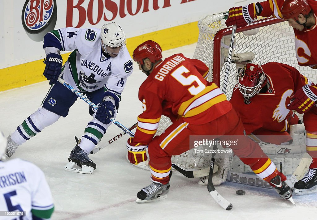 <a gi-track='captionPersonalityLinkClicked' href=/galleries/search?phrase=Alexandre+Burrows&family=editorial&specificpeople=592489 ng-click='$event.stopPropagation()'>Alexandre Burrows</a> #14 of the Vancouver Canucks comes out in front of the net during their NHL game against the Calgary Flames at the Scotiabank Saddledome on March 3, 2013 in Calgary, Alberta, Canada.