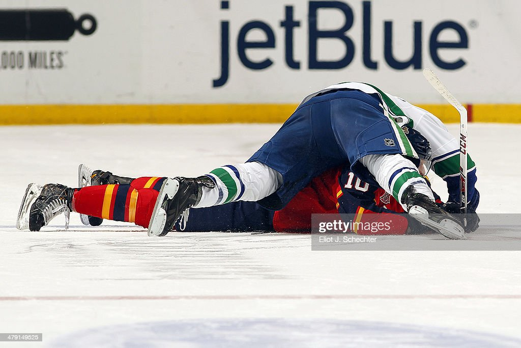 Alexandre Burrows of the Vancouver Canucks holds down Joey Crabb of the Florida Panthers at the BBT Center on March 16 2014 in Sunrise Florida
