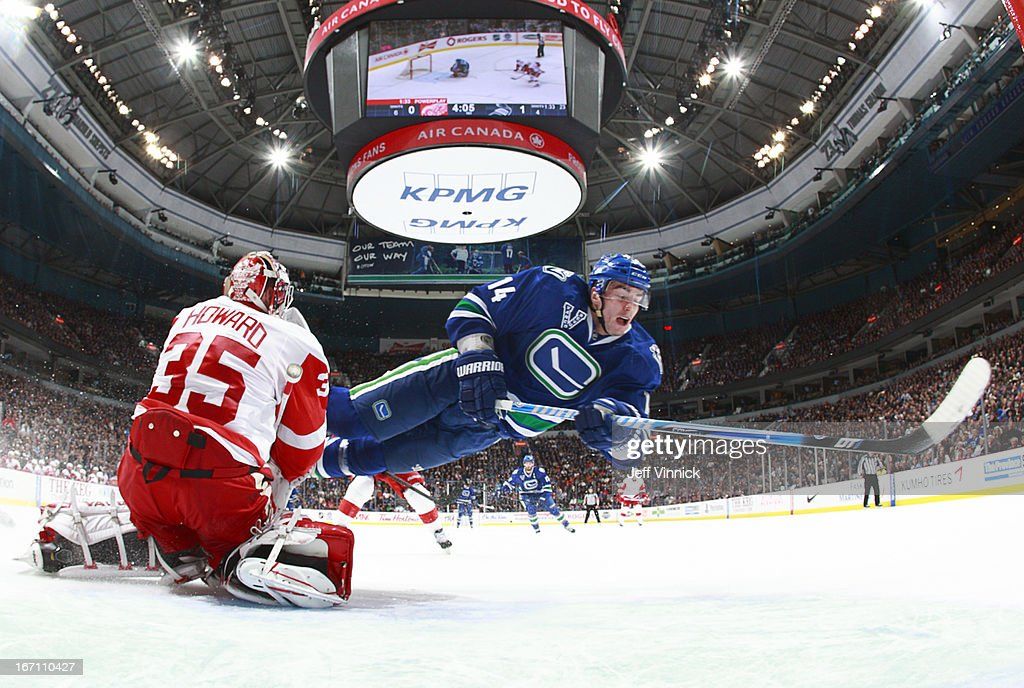 Alexandre Burrows #14 of the Vancouver Canucks is thwarted by Jimmy Howard #35 of the Detroit Red Wings on a shorthanded breakaway during their NHL game at Rogers Arena April 20, 2013 in Vancouver, British Columbia, Canada.