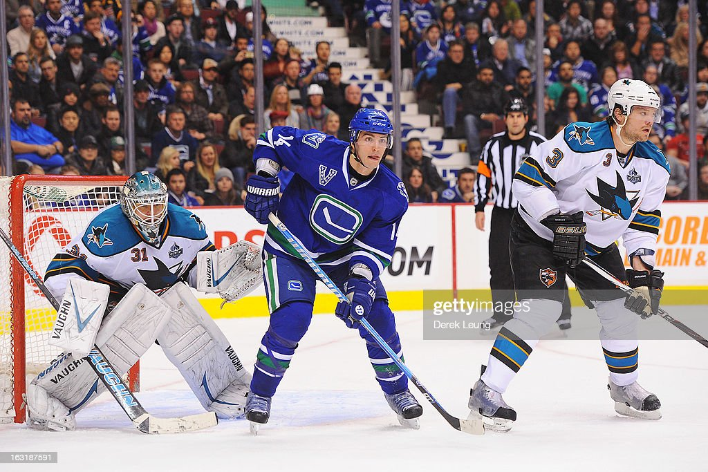 <a gi-track='captionPersonalityLinkClicked' href=/galleries/search?phrase=Alexandre+Burrows&family=editorial&specificpeople=592489 ng-click='$event.stopPropagation()'>Alexandre Burrows</a> #14 of the Vancouver Canucks looks for an opportunity in front of <a gi-track='captionPersonalityLinkClicked' href=/galleries/search?phrase=Antti+Niemi&family=editorial&specificpeople=213913 ng-click='$event.stopPropagation()'>Antti Niemi</a> #31 of the San Jose Sharks during an NHL game at Rogers Arena on March 5, 2013 in Vancouver, British Columbia, Canada.