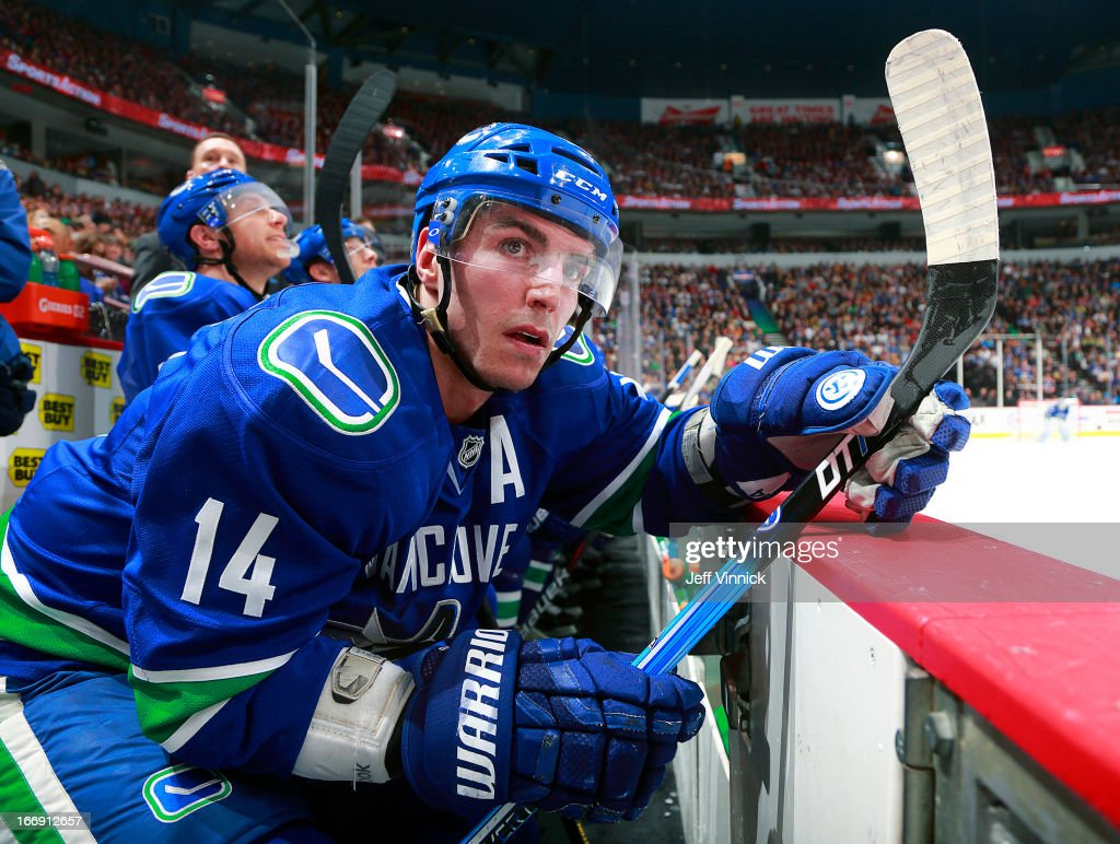 <a gi-track='captionPersonalityLinkClicked' href=/galleries/search?phrase=Alexandre+Burrows&family=editorial&specificpeople=592489 ng-click='$event.stopPropagation()'>Alexandre Burrows</a> #14 of the Vancouver Canucks looks on from the bench during their NHL game against the Edmonton Oilers at Rogers Arena April 4, 2013 in Vancouver, British Columbia, Canada. Vancouver won 4-0.