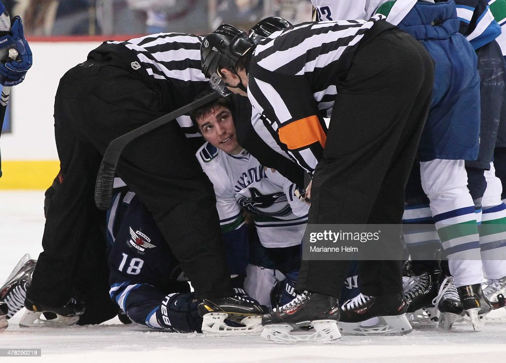 <a gi-track='captionPersonalityLinkClicked' href=/galleries/search?phrase=Alexandre+Burrows&family=editorial&specificpeople=592489 ng-click='$event.stopPropagation()'>Alexandre Burrows</a> #14 of the Vancouver Canucks looks up to officials after a tussle with <a gi-track='captionPersonalityLinkClicked' href=/galleries/search?phrase=Bryan+Little&family=editorial&specificpeople=540533 ng-click='$event.stopPropagation()'>Bryan Little</a> #18 of the Winnipeg Jets in second-period action in an NHL game at the MTS Centre on March 12, 2014 in Winnipeg, Manitoba, Canada.