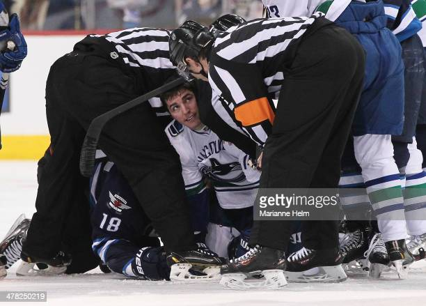Alexandre Burrows of the Vancouver Canucks looks up to officials after a tussle with Bryan Little of the Winnipeg Jets in secondperiod action in an...