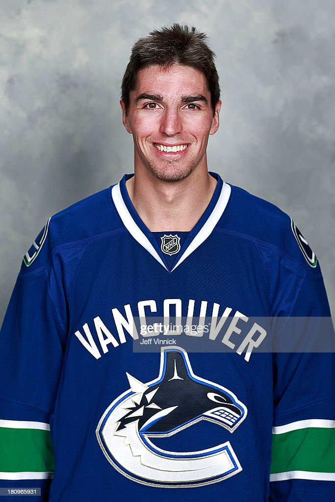 <a gi-track='captionPersonalityLinkClicked' href=/galleries/search?phrase=Alexandre+Burrows&family=editorial&specificpeople=592489 ng-click='$event.stopPropagation()'>Alexandre Burrows</a> of the Vancouver Canucks poses for his official headshot for the 2013-14 NHL season on September 11, 2013 at Rogers Arena in Vancouver, British Columbia, Canada.