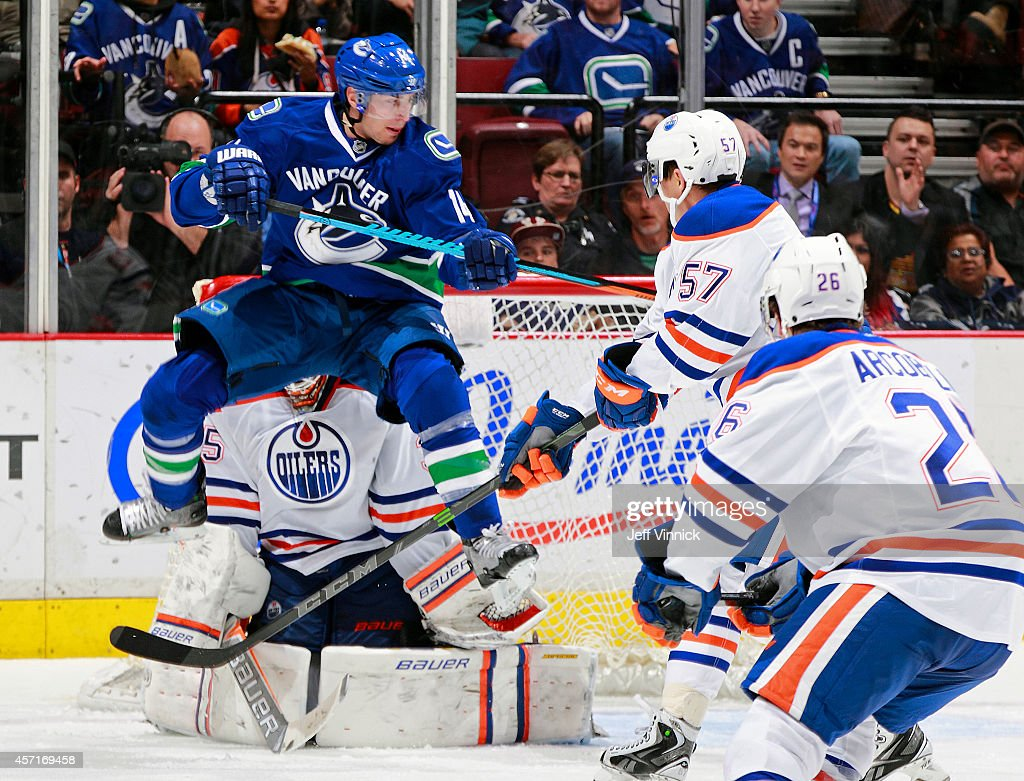 Alexandre Burrows of the Vancouver Canucks screens goalie Viktor Fasth of the Edmonton Oilers during their NHL game at Rogers Arena October 11 2014...