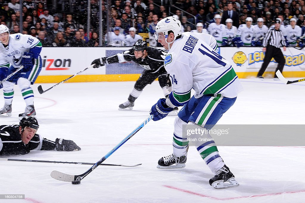<a gi-track='captionPersonalityLinkClicked' href=/galleries/search?phrase=Alexandre+Burrows&family=editorial&specificpeople=592489 ng-click='$event.stopPropagation()'>Alexandre Burrows</a> #14 of the Vancouver Canucks skates with the puck against the Los Angeles Kings at Staples Center on January 28, 2013 in Los Angeles, California.