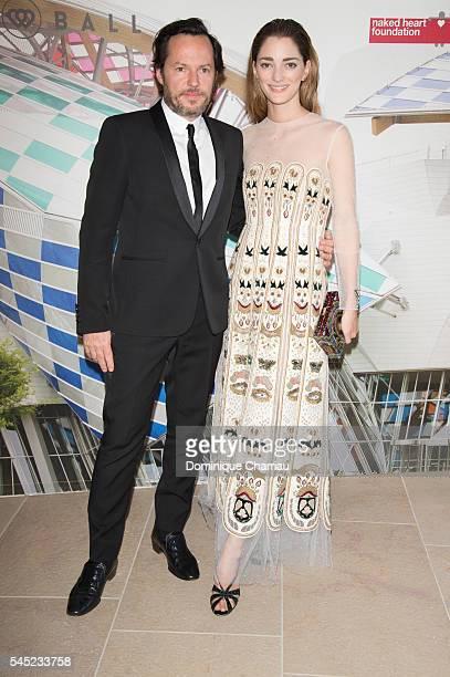 Alexandre de Betak and Sofia Sanchez de Betak attend the 'The Art of Giving' Love Ball Naked Heart Foundation Photo Call as part of Paris Fashion...