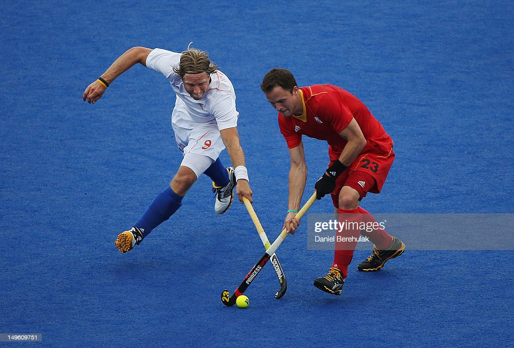 Alexandre de Saedeleer of Belgium challenges Billy Bakker of the Netherlands for the ball on Day 5 of the London 2012 Olympic Games at Riverbank Arena on August 1, 2012 in London, England.