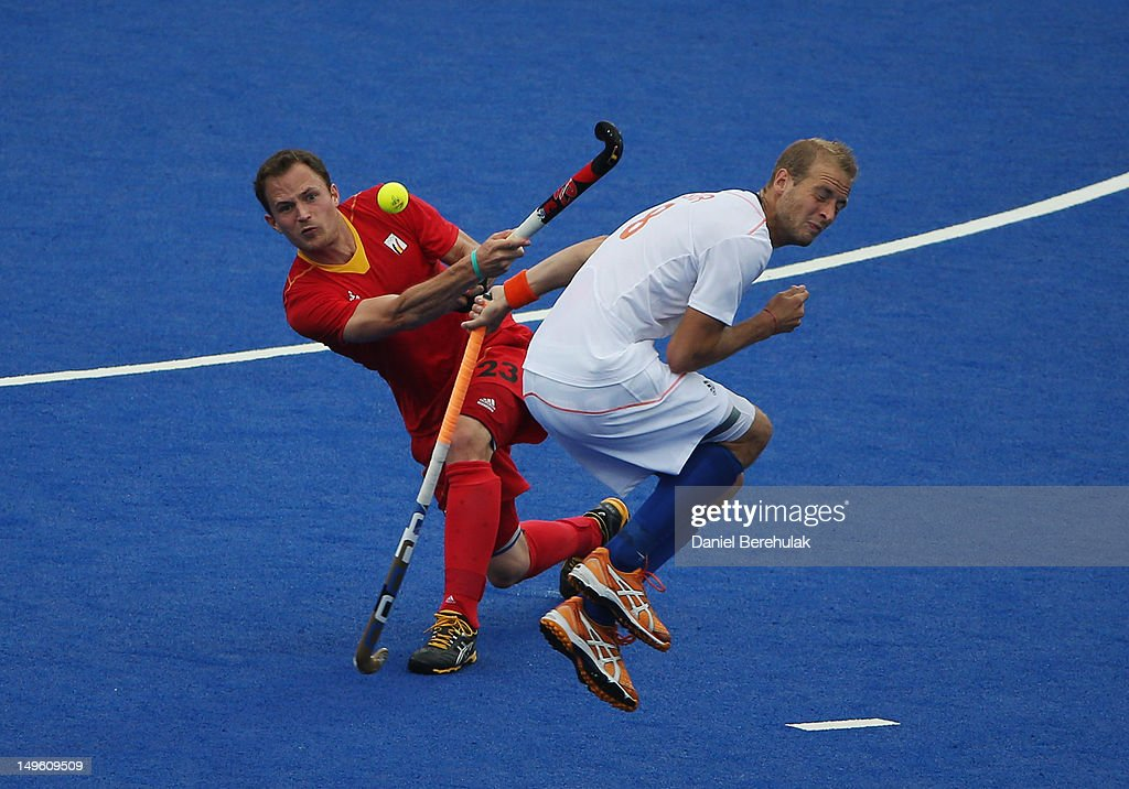Alexandre de Saedeleer of Belgium hits past Billy Bakker of the Netherlands on Day 5 of the London 2012 Olympic Games at Riverbank Arena on August 1, 2012 in London, England.
