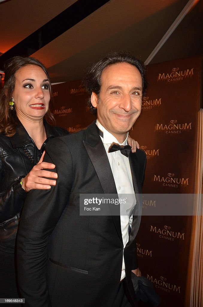 <a gi-track='captionPersonalityLinkClicked' href=/galleries/search?phrase=Alexandre+Desplat&family=editorial&specificpeople=4162223 ng-click='$event.stopPropagation()'>Alexandre Desplat</a> and a guest attend La Vie D'Adele Palme d'Or Party At The Magnum Cannes Plage - The 66th Annual Cannes Film Festival on May 26, 2013 in Cannes, France.