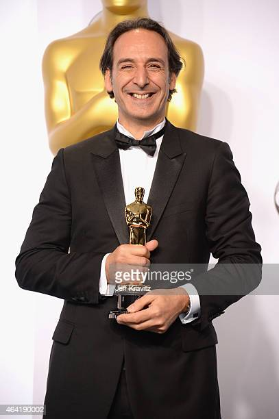Alexandre Desplat with the award for best original score for 'The Grand Budapest Hotel' poses in the press room during the 87th Annual Academy Awards...