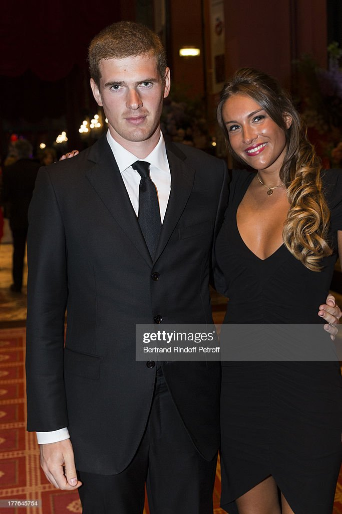 Alexandre Desseigne, the son of President of Barriere Group Dominique Desseigne (L) and Flore Cluzel attend the Grand Bal Care in Deauville on August 24, 2013 in Deauville, France. Care France, the French branch of the humanitarian aid organization Care, was celebrating its 30th anniversary on Saturday.
