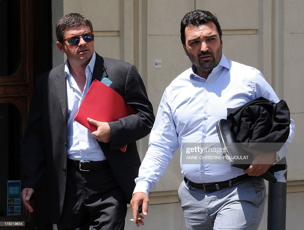 Alexandre Guerini (L), an entrepreneur specialized in waste management and brother of the president of the General Council of the Bouches-du-Rhone, arrives with his lawyer Jean-Charles Vincensini (R), on July 10, 2013 at the courthouse in Marseille, southern France, to be heard by a judge as part of an inquiry into alleged fraudulent public contracts.
