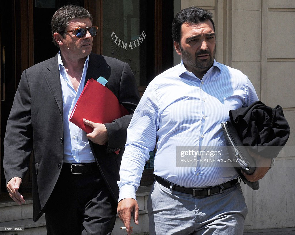 Alexandre Guerini (L), an entrepreneur specialized in waste management and brother of the president of the General Council of the Bouches-du-Rhone, arrives with his lawyer Jean-Charles Vincensini (R), on July 10, 2013 at the courthouse in Marseille, southern France, to be heard by a judge as part of an inquiry into alleged fraudulent public contracts. AFP PHOTO / ANNE-CHRISTINE POUJOULAT