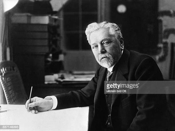 Alexandre Gustave Eiffel french engineer and architect on his desk about 1913