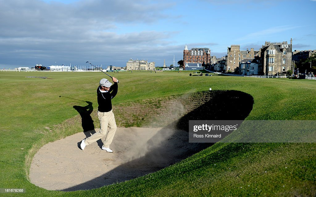 Alexandre Kaleka of France plays out of the road hole bunker during a practice round prior to the 2013 Alfred Dunhill Links Championship on The Old...