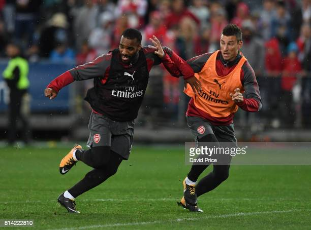 Alexandre Lacazette and Laurent Koscielny of Arsenal during the Open Arsenal Training Session at the ANZ Stadium on July 14 2017 in Sydney Australia