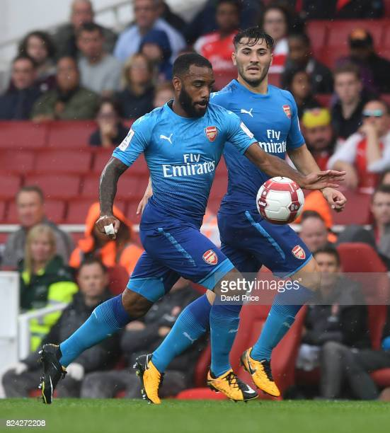 Alexandre Lacazette and Sead Kolasinac of Arsenal during the match between Arsenal and SL Benfica at Emirates Stadium on July 29 2017 in London...