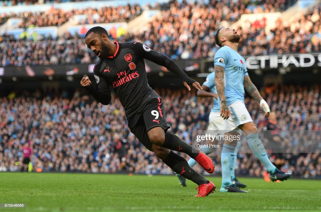 Alexandre Lacazette celebrates scoring a goal for Arsenal during the Premier League match between Manchester City and Arsenal at Etihad Stadium on November 5, 2017 in Manchester, England.