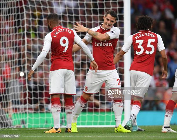 Alexandre Lacazette celebrates scoring Arsenal's 1st goal with Granit Xhaka during the Premier League match between Arsenal and Leicester City at...
