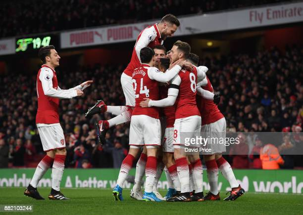 Alexandre Lacazette celebrates scoring Arsenal's 1st goal with his team mates during the Premier League match between Arsenal and Huddersfield Town...