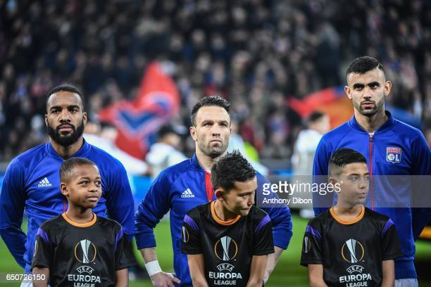 Alexandre Lacazette Mathieu Valbuena and Rachid Ghezzal of Lyon during the Uefa Europa League Round of 16 first leg match between Olympique Lyonnais...