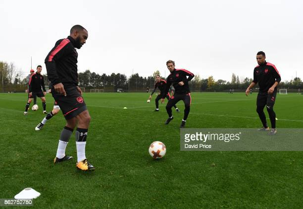 Alexandre Lacazette Nacho Monreal and Francis Coquelin of Arsenal during the Arsenal Training Session at London Colney on October 18 2017 in St...
