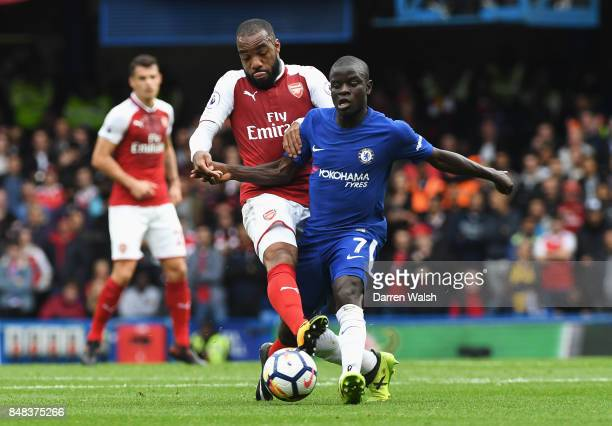 Alexandre Lacazette of Arsenal and N'Golo Kante of Chelsea battle for possession during the Premier League match between Chelsea and Arsenal at...