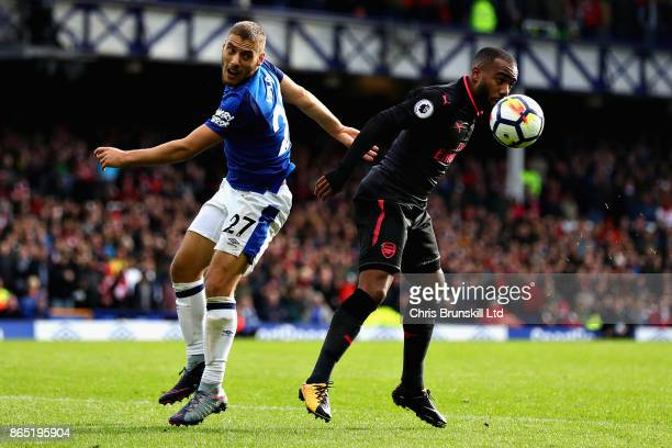 Alexandre Lacazette of Arsenal and Nikola Vlasic of Everton in action during the Premier League match between Everton and Arsenal at Goodison Park on...