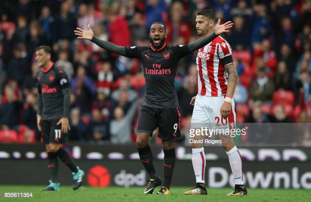 Alexandre Lacazette of Arsenal appeals to the referee after his goal was disallowed during the Premier League match between Stoke City and Arsenal at...