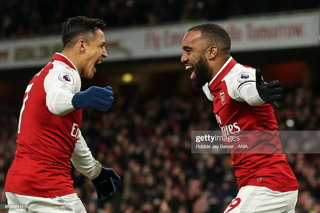 Alexandre Lacazette of Arsenal celebrates after scoring a goal to make it 1-0 during the Premier League match between Arsenal and Huddersfield Town at Emirates Stadium on November 28, 2017 in London, England.