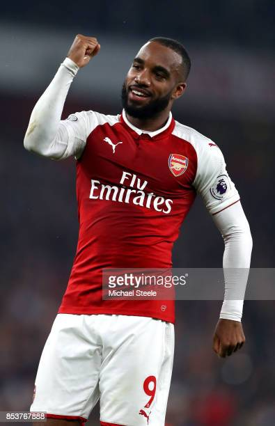 Alexandre Lacazette of Arsenal celebrates as he scores their second goal from a penalty during the Premier League match between Arsenal and West...