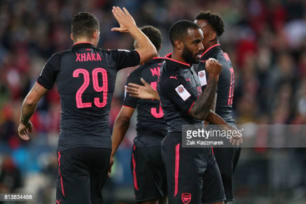 Alexandre Lacazette of Arsenal celebrates scoring a goal with team mates during the match between Sydney FC and Arsenal FC at ANZ Stadium on July 13...