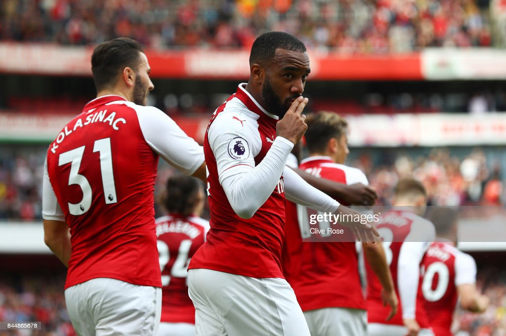 Alexandre Lacazette of Arsenal celebrates scoring his sides first goal with his Arsenal team mates during the Premier League match between Arsenal and AFC Bournemouth at Emirates Stadium on September 9, 2017 in London, England.
