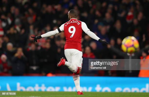 Alexandre Lacazette of Arsenal celebrates scoring his sides first goal during the Premier League match between Arsenal and Huddersfield Town at...