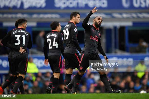 Alexandre Lacazette of Arsenal celebrates scoring his sides third goal with his Arsenal team mates during the Premier League match between Everton...