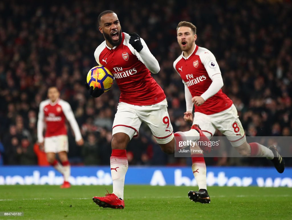 Alexandre Lacazette of Arsenal celebrates scoring his teams first goal past David De Gea of Manchester United to make it 2-1 during the Premier League match between Arsenal and Manchester United at Emirates Stadium on December 2, 2017 in London, England.
