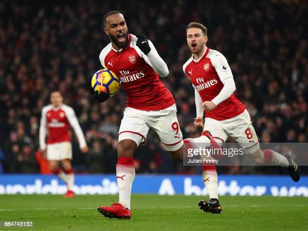 Alexandre Lacazette of Arsenal celebrates scoring his teams first goal past David De Gea of Manchester United to make it 21 during the Premier League...