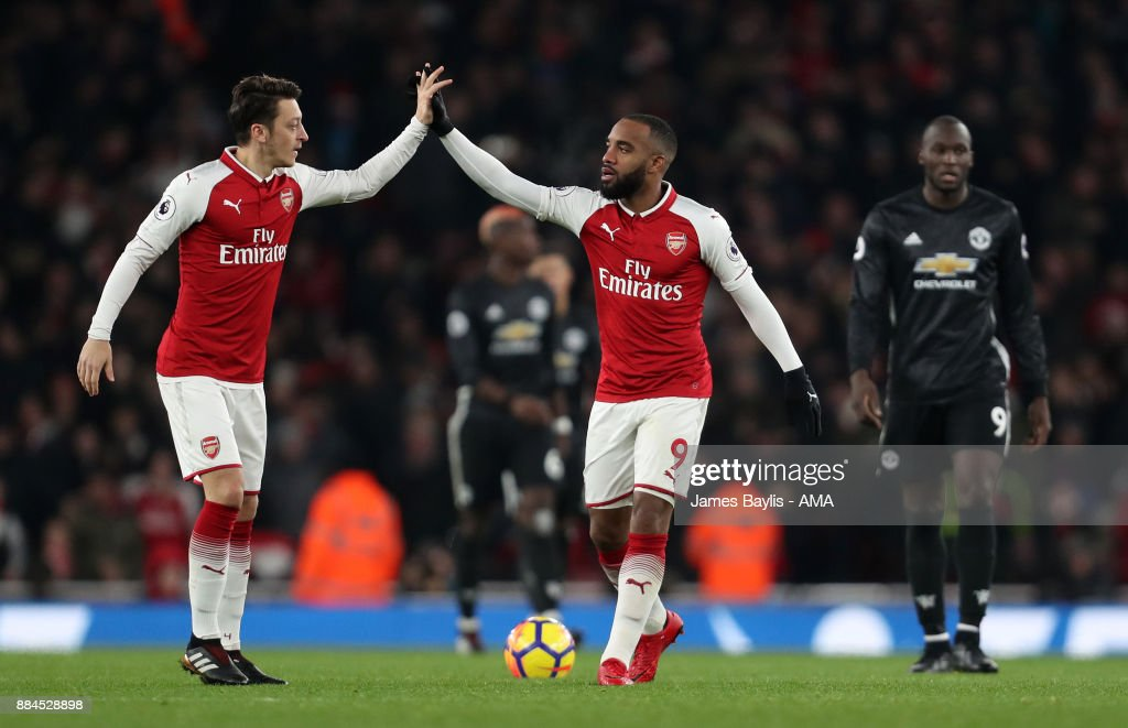 http://media.gettyimages.com/photos/alexandre-lacazette-of-arsenal-celebrates-with-mesut-ozil-of-arsenal-picture-id884528898?k=6&m=884528898&s=594x594&w=0&h=rbh9txdxk8C66pbeEputxDkjqvPerM5LbMIYhdDGytQ=