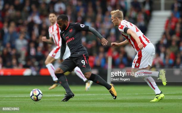 Alexandre Lacazette of Arsenal moves away from Darren Fletcher during the Premier League match between Stoke City and Arsenal at Bet365 Stadium on...